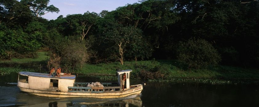 A river boat carrying locals, travel up the Amazon.