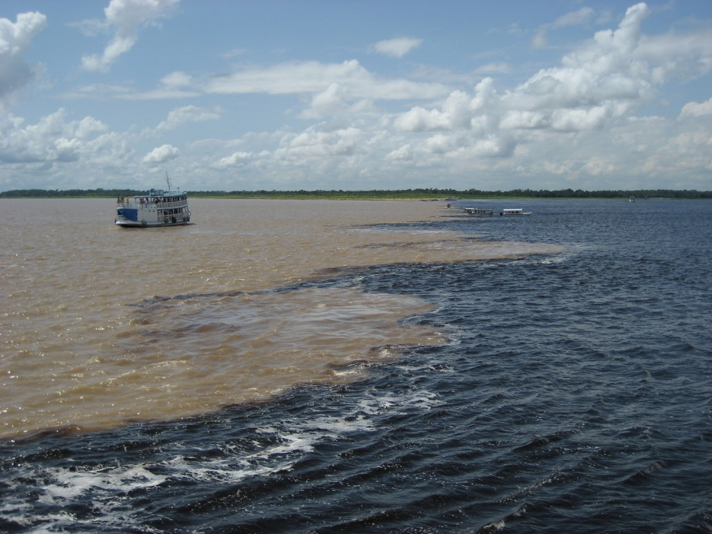 The black waters of Rio negro meet the murky waters of Rio Solimoes.