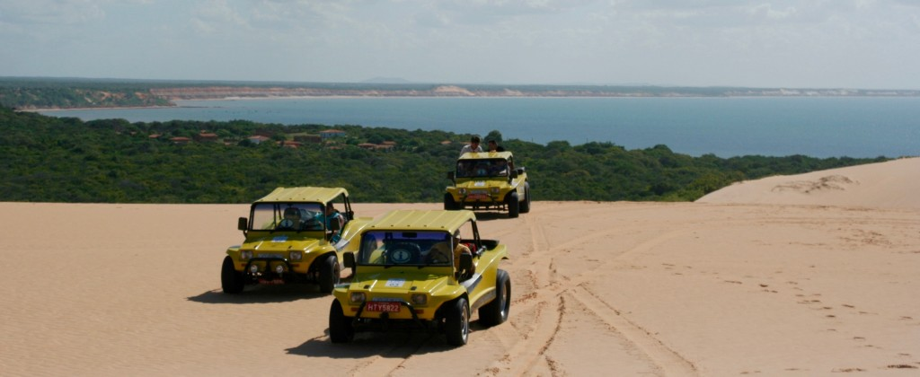Buggies parked on top of a dune near Natal.