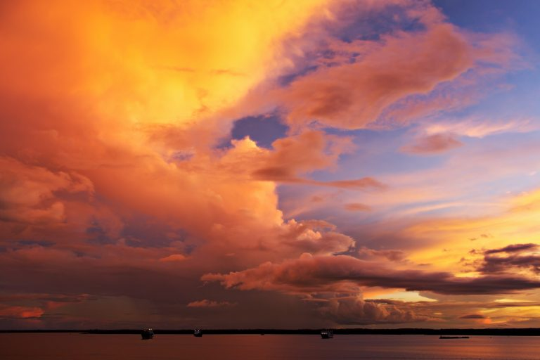 A beautiful sunset sets the sky on fire over the Rio Negro.