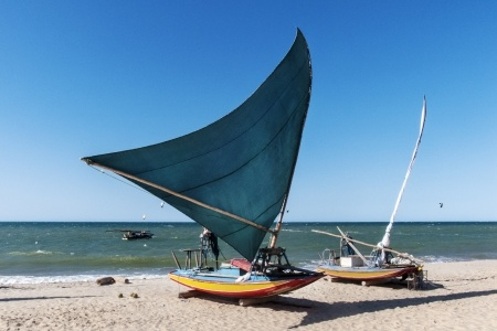 Two sail boats sit on the beach in Jericoacoara.