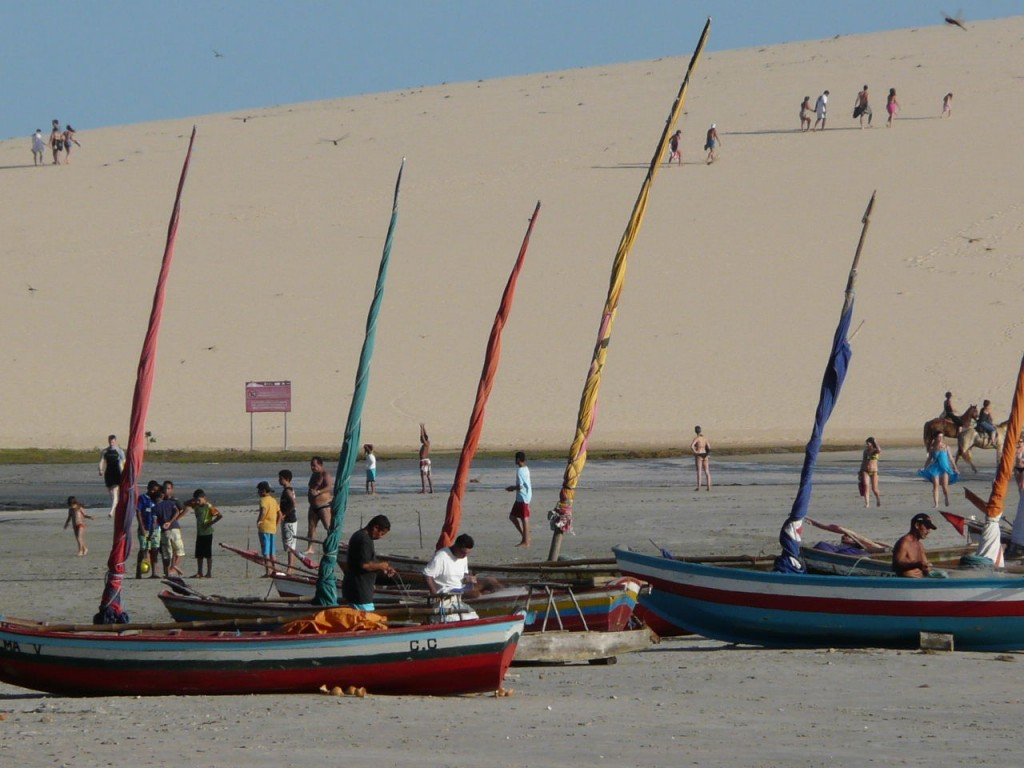 People getting ready to sail their jangadas in Jericoacoara.