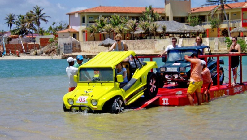 Buggys getting ready to cross a lagoon by ferry.