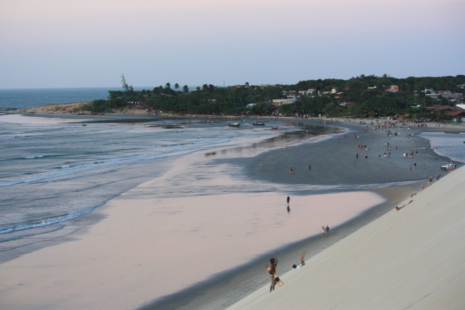 Jericoacoara beach at low tide from the top of a dune.