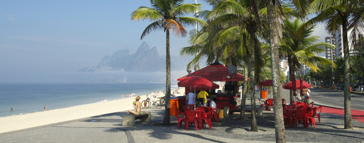 Some people enjoy a sunny day at Ipanema beach in Rio de Janeiro.