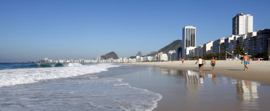 A shot of Copacabana beach with Rio de Janeiro city in the background.