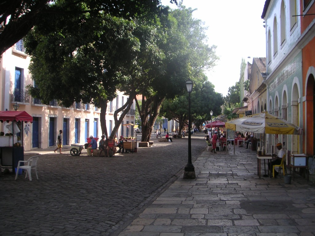 A cobbled Brazilian street lined with trees.