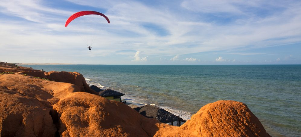 Jumping from a parachute in Canoa Quebrada.