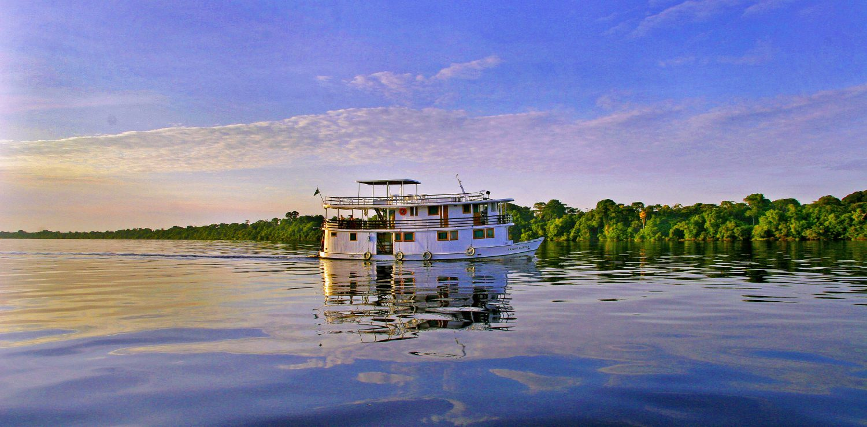 Amazon boat at sunset