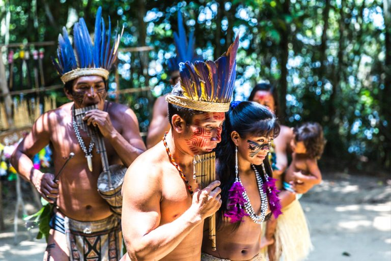 Indigenous people of the Amazon showing some of their culture.