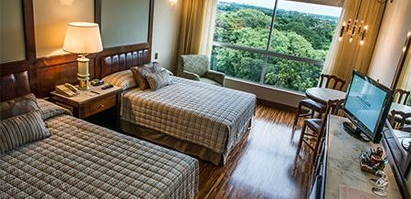 Bedroom in Hotel Bourbon with a beautiful view from the window.