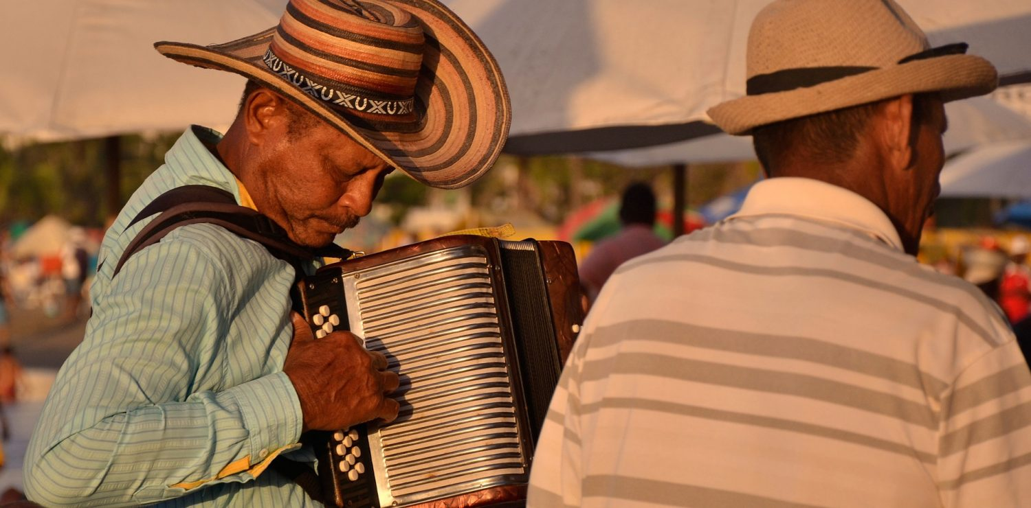 Man plays forro music in the sunset.
