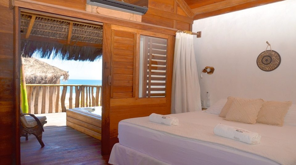 Bedroom in Hotel hurricane Jeri, with opening out onto beach terrace.