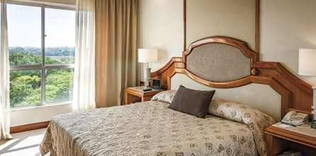 An elegant room with a beautiful view at hotel das cataratas.