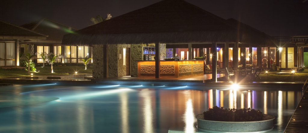 The pool at Zorah beach, lit by pleasant night lights.