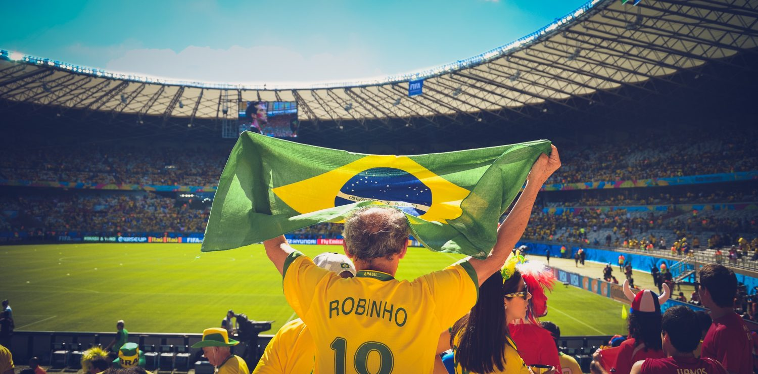 Brazilian football supporter hoists flag