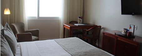 Room at the hotel Olinda in Rio de Janeiro with the sun shining in through the window.