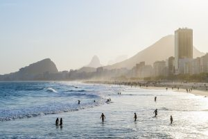 Rio de Janeiro beach, with the city and mountains in the background.