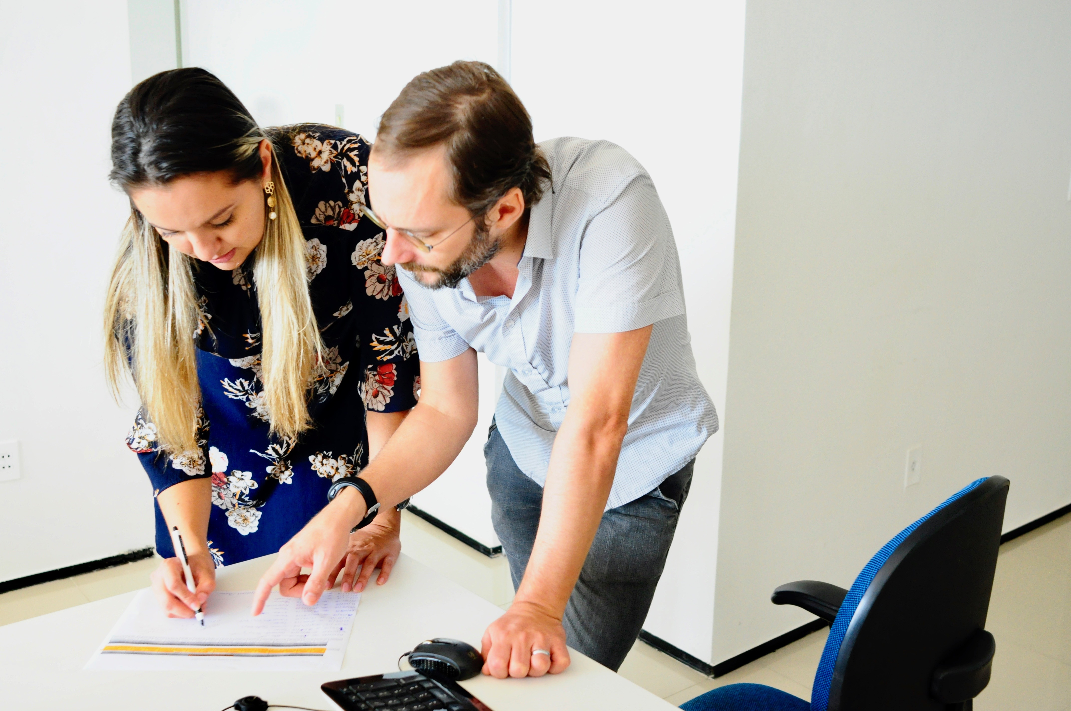 Pierre and Gloria working in a clients proposal.