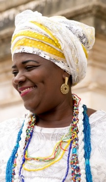 A smiling woman from Bahia in traditional dress.