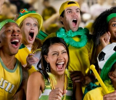 A group of Brazilian football supporters cheer on their team.