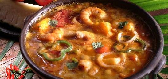 African inspired dish in Brazil called moqueca de peixe com camarao.