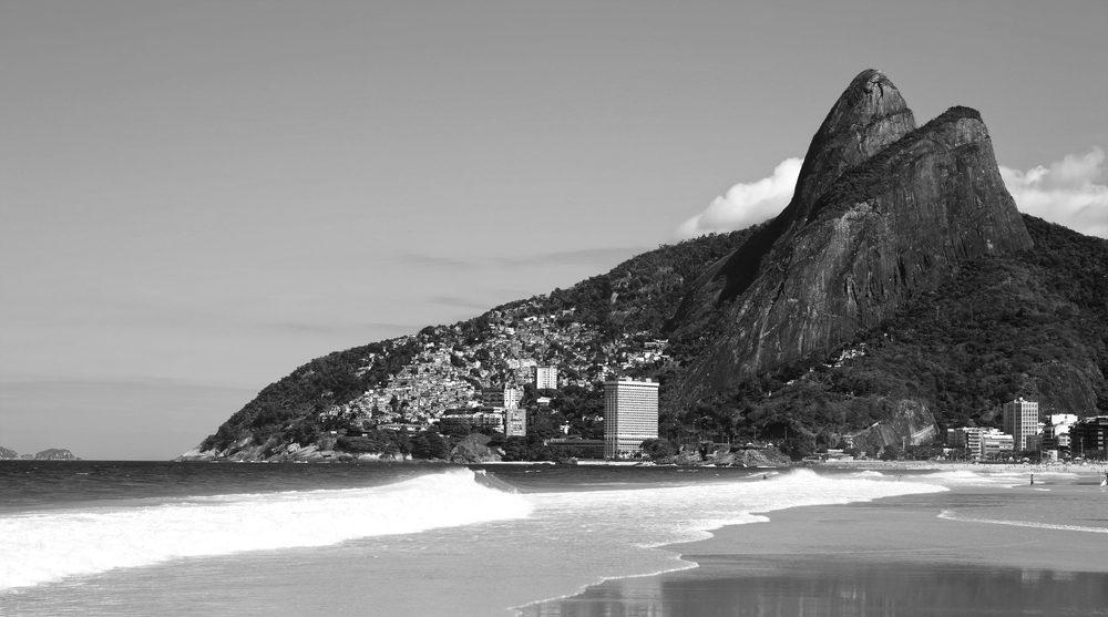 Rio de Janeiro beach with mountain in back right.