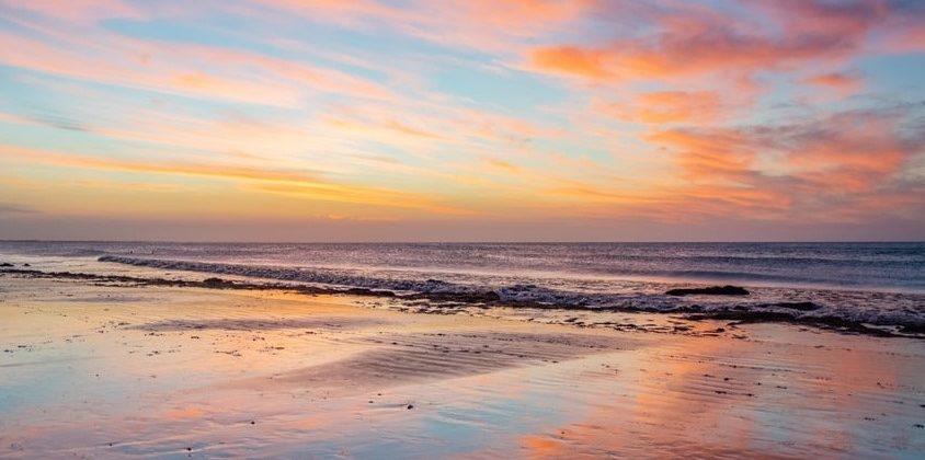 Jericoacoara sunset reflection on beach